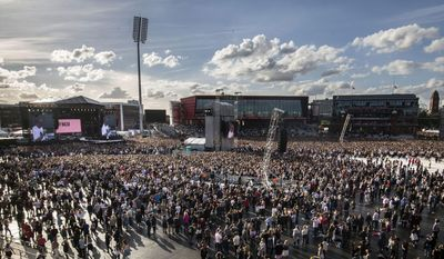 In this Sunday, June 4, 2017, handout photo provided by Danny Lawson for One Love Manchester, members of the crowd at the One Love Manchester tribute concert in Manchester, north western England, Sunday, June 4, 2017. One Love Manchester is raising money for those affected by the bombing at the end of Ariana Grande's concert in Manchester on May 22, 2017. (Danny Lawson via AP)
