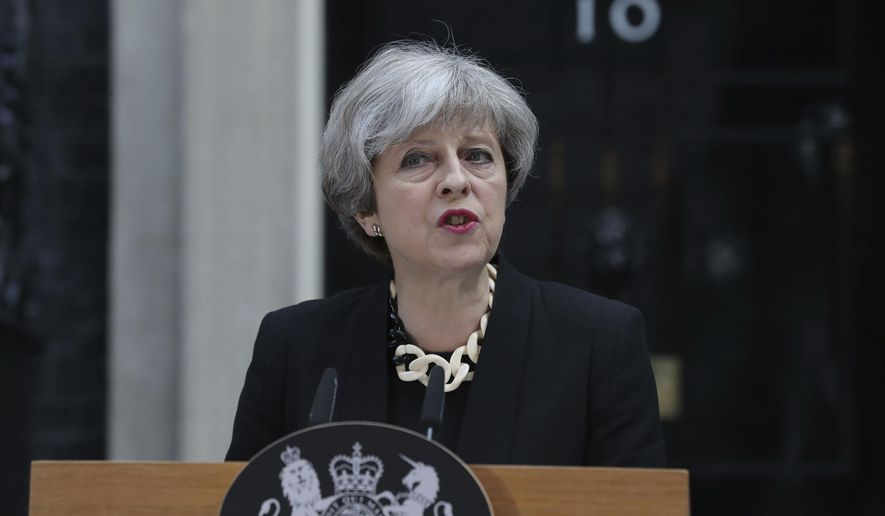 Britain's Prime Minister Theresa May makes a statement in Downing Street, London, after chairing a meeting of the Government's emergency Cobra committee following Saturday night's terrorist incident in London. Several people were killed in the terror attack at the heart of London and dozens injured. The prime minister called for a tougher stance at home against extremists.  (Andrew Matthews/PA via AP)