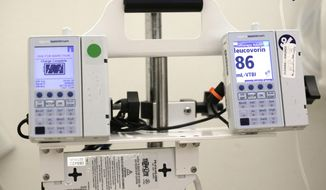 This Thursday, May 25, 2017 photo shows equipment that administers chemotherapy drugs at the North Carolina Cancer Hospital in Chapel Hill, N.C. A study that had patients use home computers to report problems like nausea and fatigue improved survival _ by nearly half a year, longer than many new cancer drugs do. (AP Photo/Gerry Broome)