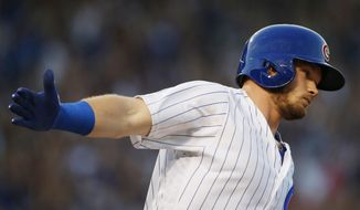 Chicago Cubs' Ian Happ celebrates as he rounds the bases after hitting a three-run home run during the fourth inning of a baseball game against the St. Louis Cardinals, Sunday, June 4, 2017, in Chicago. (AP Photo/Nam Y. Huh)