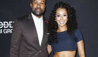 "FILE - In this March 29, 2016 file photo, former Los Angeles Lakers player and New York Knicks head coach Derek Fisher, left, and Gloria Govan attend the LA Premiere of ""Meet the Blacks"" in Los Angeles. Authorities say Fisher has been arrested on suspicion of drunken driving after he flipped his vehicle on a California highway. The California Highway Patrol says neither Fisher nor his passenger, former ""Basketball Wives"" reality star Gloria Govan, were injured in the crash early Sunday, June 4, 2017. (Photo by John Salangsang/Invision/AP, File)"