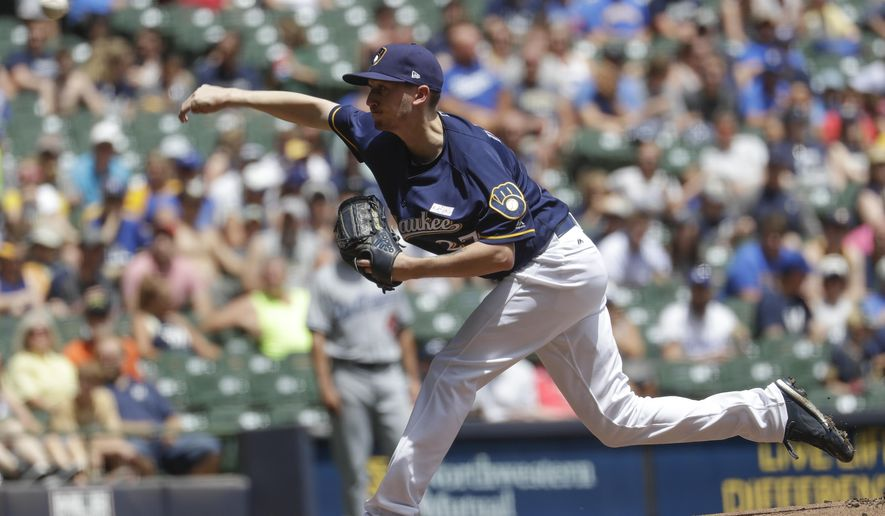 Milwaukee Brewers starting pitcher Zach Davies throws during the first inning of a baseball game against the Los Angeles Dodgers Sunday, June 4, 2017, in Milwaukee. (AP Photo/Morry Gash)