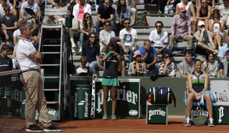 Karolina Pliskova of the Czech Republic, right, waits as Germany's Carina Witthoeft is late before their third round match of the French Open tennis tournament at the Roland Garros stadium, Sunday, June 4, 2017 in Paris. (AP Photo/Petr David Josek)