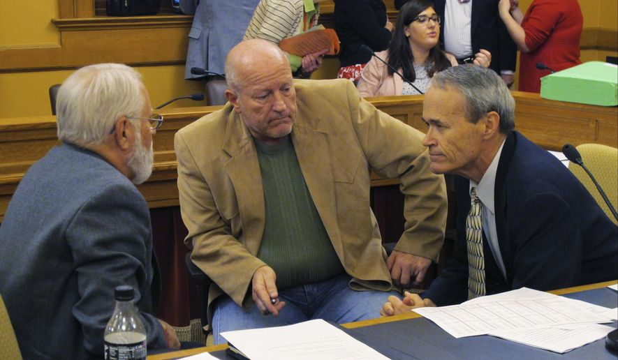 Kansas House members negotiating with the Senate on education funding confer during a break in talks that led to a plan that both increases spending on public schools and raises income taxes to help pay for it, Sunday, June 4, 2017, at the Statehouse in Topeka, Kan. They are Reps. Ed Trimmer, D-Winfield, from left, Larry Campbell, R-Olathe, the House team's leader, and Clay Aurand, R-Belleville. (AP Photo/John Hanna)