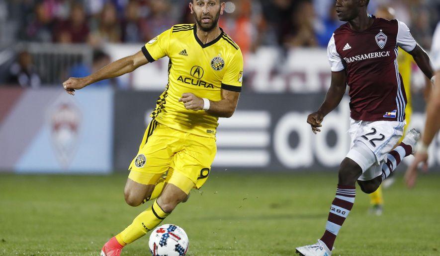 Columbus Crew forward Justin Meram, left, drives past Colorado Rapids midfielder Michael Azira for a shot during the second half of an MLS soccer match Saturday, June 3, 2017, in Commerce City, Colo. The Rapids won 2-1. (AP Photo/David Zalubowski)