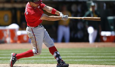 Washington Nationals' Ryan Zimmerman hits a three-run home run against the Oakland Athletics during the eighth inning of a baseball game on Sunday, June 4, 2017, in Oakland, Calif. (AP Photo/Tony Avelar)