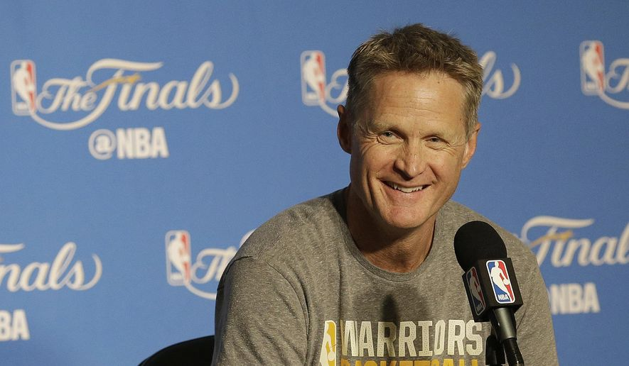 Golden State Warriors head coach Steve Kerr smiles while speaking at a news conference before Game 2 of basketball's NBA Finals between the Warriors and the Cleveland Cavaliers in Oakland, Calif., Sunday, June 4, 2017. (AP Photo/Jeff Chiu)
