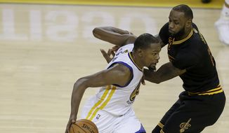 Golden State Warriors forward Kevin Durant, left, drives on Cleveland Cavaliers forward LeBron James during the second half of Game 2 of basketball's NBA Finals in Oakland, Calif., Sunday, June 4, 2017. (AP Photo/Ben Margot)