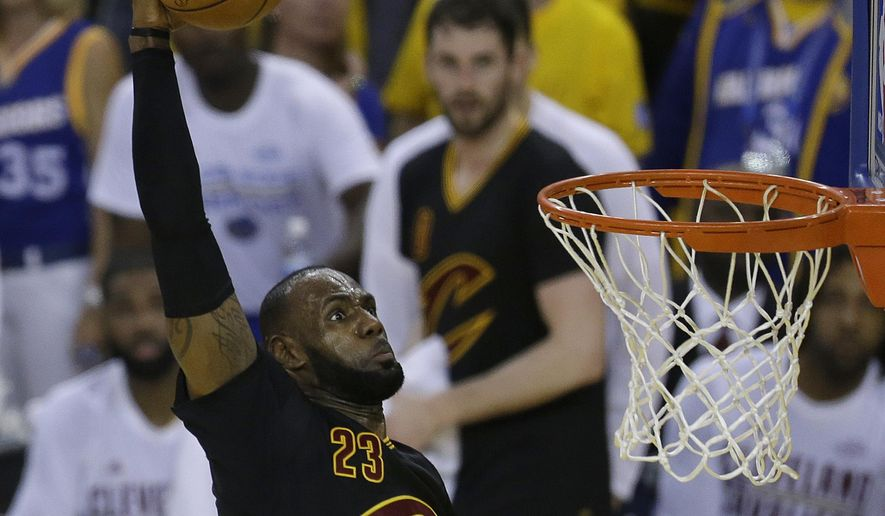 Cleveland Cavaliers forward LeBron James (23) dunks against the Golden State Warriors during the first half of Game 2 of basketball's NBA Finals in Oakland, Calif., Sunday, June 4, 2017. (AP Photo/Ben Margot)