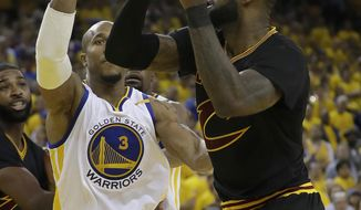 Cleveland Cavaliers forward LeBron James, right, shoots against Golden State Warriors forward David West (3) during the second half of Game 2 of basketball's NBA Finals in Oakland, Calif., Sunday, June 4, 2017. (AP Photo/Marcio Jose Sanchez)