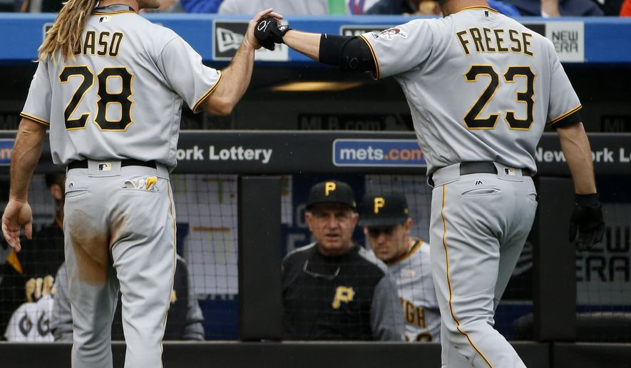 Pittsburgh Pirates John Jaso (28) celebrates with Pirates' David Freese (23) after scoring on Freese's third inning sacrifice fly in a baseball game against the New York Mets, Sunday, June 4, 2017, in New York. (AP Photo/Kathy Willens)