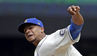 Seattle Mariners starting pitcher Ariel Miranda throws against the Tampa Bay Rays in the second inning of a baseball game Sunday, June 4, 2017, in Seattle. (AP Photo/Elaine Thompson)
