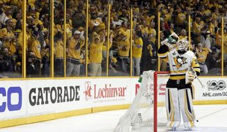 Nashville Predators fans cheer as Pittsburgh Penguins goalie Matt Murray (30) takes a drink after a Predators goal during the third period in Game 3 of the NHL hockey Stanley Cup Finals Saturday, June 3, 2017, in Nashville, Tenn. (AP Photo/Mark Humphrey)