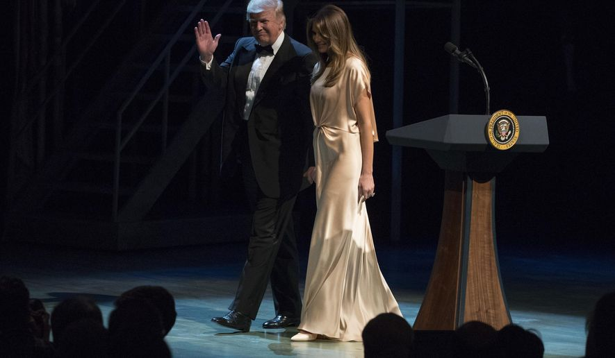 President Donald Trump and first lady Melania Trump walk from the stage during the Ford's Theatre Annual Gala at the Ford's Theatre in Washington, Sunday, June 4, 2017. (AP Photo/Carolyn Kaster)