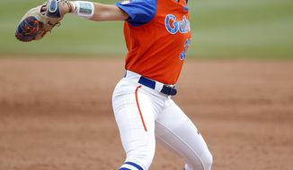 Florida's Delanie Gourley (33) throws a pitch in the third inning during the Women's College World Series softball game against Washington in Oklahoma City, Sunday, June 4, 2017 (Sarah Phipps/The Oklahoman via AP)