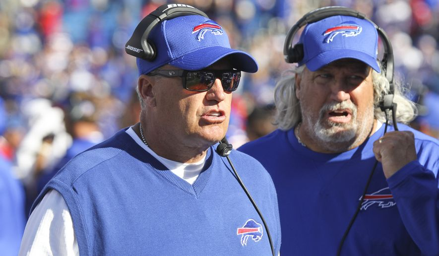 Buffalo Bills head coach Rex Ryan, left, and coach Rob Ryan work on the sidelines during the second half of an NFL football game against the Arizona Cardinals on Sunday, Sept. 25, 2016, in Orchard Park, N.Y. Buffalo won 33-18. (AP Photo/Jeffrey T. Barnes)