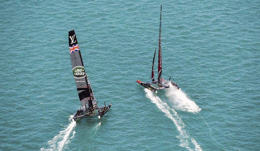 In this photo provided by America's Cup Event Authority, Emirates Team New Zealand and Great Britain's Land Rover BAR compete compete during America's Cup challenger semifinals on the Great Sound in Bermuda on Monday, June 5, 2017.  (Ricardo Pinto/ACEA via AP)