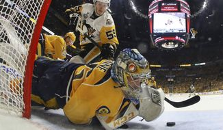 Nashville Predators goalie Pekka Rinne (35), of Finland, stops a shot by Pittsburgh Penguins center Jake Guentzel (59) during the second period in Game 4 of the NHL hockey Stanley Cup Final Monday, June 5, 2017 in Nashville, Tenn. (Bruce Bennett/Pool Photo via AP)