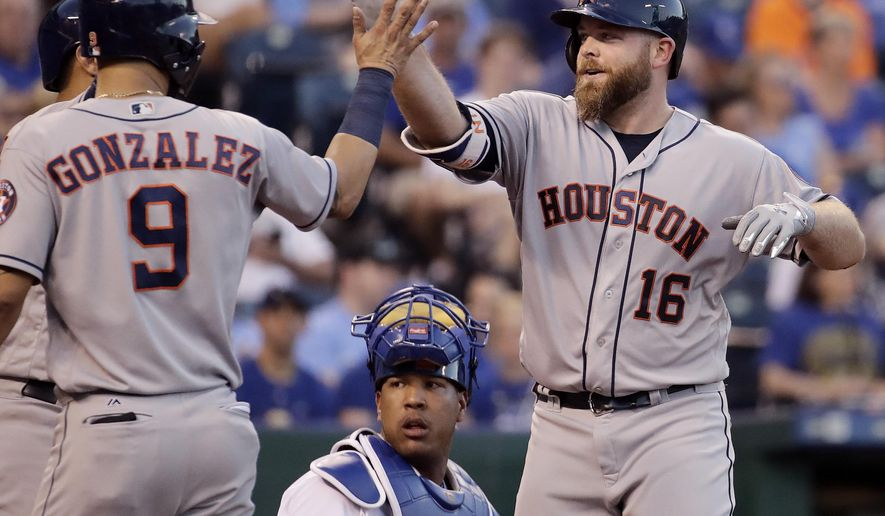 Houston Astros' Brian McCann (16) celebrates with Marwin Gonzalez (9) after hitting a two-run home run during the fourth inning of a baseball game against the Kansas City Royals, Monday, June 5, 2017, in Kansas City, Mo. (AP Photo/Charlie Riedel)