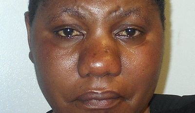 This April 2017 booking photo released by the Concord Police Department shows Joyce Chance, arrested in Concord, N.H., on multiple assault charges and accused of beating her two children with a broomstick. The lawyer for Chance, a refugee from the Congo, said her experience in the justice system has been marked by miscommunication and a lack of information. Authorities said her actions went well beyond physical discipline. (Concord Police via AP)