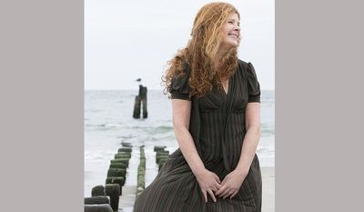 """This 2016 image released by Lee Boudreaux Books shows Jill Eisenstadt, author of """"Swell,"""" her first novel in 26 years. She is also the author of  """"From Rockaway"""" and """"Kiss Out."""" (Beowulf Sheehan/Lee Boudreaux Books via AP)"""