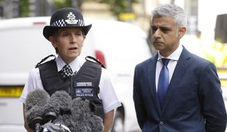 London Police Commissioner Cressida Dick, left, and the Mayor of London Sadiq Khan, participate in a media conference at London Bridge in London, Monday, June 5, 2017. Police arrested several people and are widening their investigation after a series of attacks described as terrorism killed several people and injured more than 40 others in the heart of London on Saturday. (AP Photo/Alastair Grant)