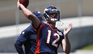 Denver Broncos quarterback Paxton Lynch throws a pass during the team's NFL football minicamp session Monday, June 5, 2017, in Englewood, Colo. (AP Photo/David Zalubowski)