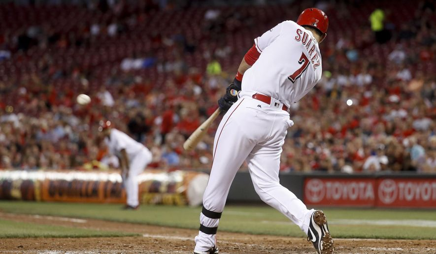 Cincinnati Reds' Eugenio Suarez hits a game-tying two-run double off St. Louis Cardinals starting pitcher Carlos Martinez in the seventh inning of a baseball game, Monday, June 5, 2017, in Cincinnati. (AP Photo/John Minchillo) tie