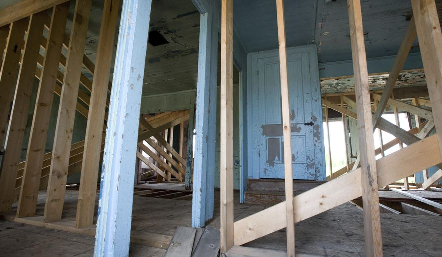 This May 9, 2017 photo, shows the interior of the Daniel Schrock home near Chesterville  Ill. The structure is to be part of the new Illinois Amish Heritage Center near Chesterville. The Daniel Schrock and Moses Yoder houses will be the focal points of the site after being restored to their 19th century appearance and will showcase the area's Amish heritage. (Kevin Kilhoffer/Journal Gazette via AP)