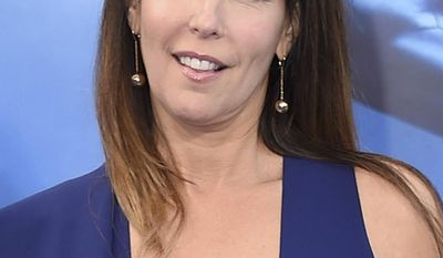 """FILE - In this May 25, 2017 file photo, director Patty Jenkins arrives at the world premiere of her film, """"Wonder Woman"""" in Los Angeles. Jenkins' """"Wonder Woman"""" grossed $103.1 million in North America over its debut weekend, a figure that easily surpassed industry expectations, set a new record for a film directed by a woman and bested all previous stand-alone female superhero movies put together.(Photo by Jordan Strauss/Invision/AP, File)"""