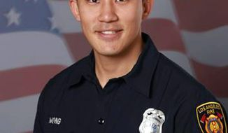 This undated photo provided by the Los Angeles Fire Department shows firefighter Kelly Wong. The department announced that Wong, 29, died early Monday, June 5, 2017 after he was injured in a fall from a ladder during a downtown training exercise Saturday, June 3. When Wong fell he was treated by fellow firefighters and paramedics and then was rushed to a hospital in critical condition. The 2-year veteran is survived by his wife and infant son. (Los Angeles Fire Department via AP)