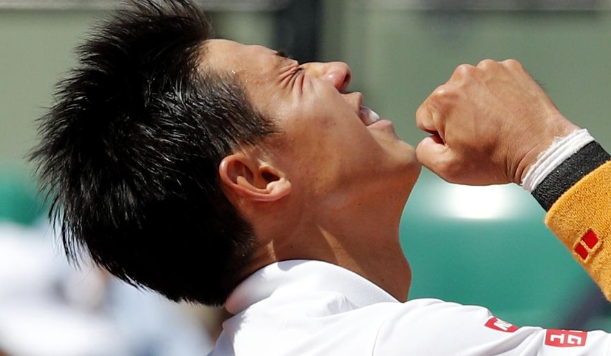 Japan's Kei Nishikori reacts as he defeats Spain's Fernando Verdasco during their fourth round match of the French Open tennis tournament at the Roland Garros stadium, Monday, June 5, 2017 in Paris. (AP Photo/Christophe Ena)