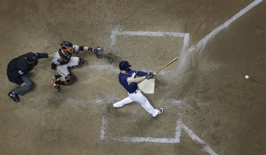 Milwaukee Brewers' Brett Phillips hits a single during the eighth inning of a baseball game against the San Francisco Giants Monday, June 5, 2017, in Milwaukee. The hit was Phillip's first major league hit. (AP Photo/Morry Gash)