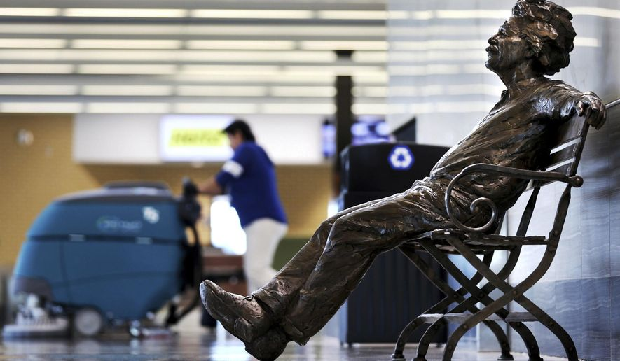 A wave of new public art pieces for Grand Island, Neb., has begun with a statue of Albert Einstein at the Central Nebraska Regional Airport in Grand Island. Grand Island businessman and developer Ray O'Connor, who donated the piece, has also donated similar statues of Mark Twain and St. Francis of Assisi. When ready, Twain will reside at the Grand Island Public Library and Assisi will be on the grounds of St. Mary's Cathedral. A group of attorneys is working to place a similar statue of George Washington at the Hall County Courthouse in Grand Island, and original pieces by artist Jun Kaneko are to be placed at Railside Plaza in downtown Grand Island on June 8. (Barrett Stinson/The Grand Island Independent via AP)