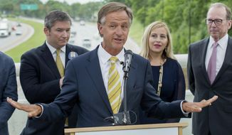 Republican Gov. Bill Haslam speaks about his road funding program called the Improve Act during a ceremonial bill signing event in Nashville, Tenn., Monday, June 5, 2017. At rear from right are state Transportation Commissioner John Schroer, Nashville Mayor Megan Barry and state Sen. Jeff Yarbro, D-Nashville. (AP Photo/Erik Schelzig)