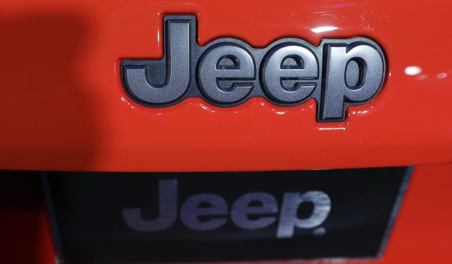 FILE - In this Thursday, Nov. 17, 2016, file photo, the Jeep logo is displayed on a car at the Los Angeles Auto Show in Los Angeles. The U.S. government is investigating complaints that air bag control computers in some Jeep Liberty SUVs can fail, preventing the air bags from inflating in a crash. The probe covers about 105,000 of the vehicles from the 2012 model year. (AP Photo/Chris Carlson, File)