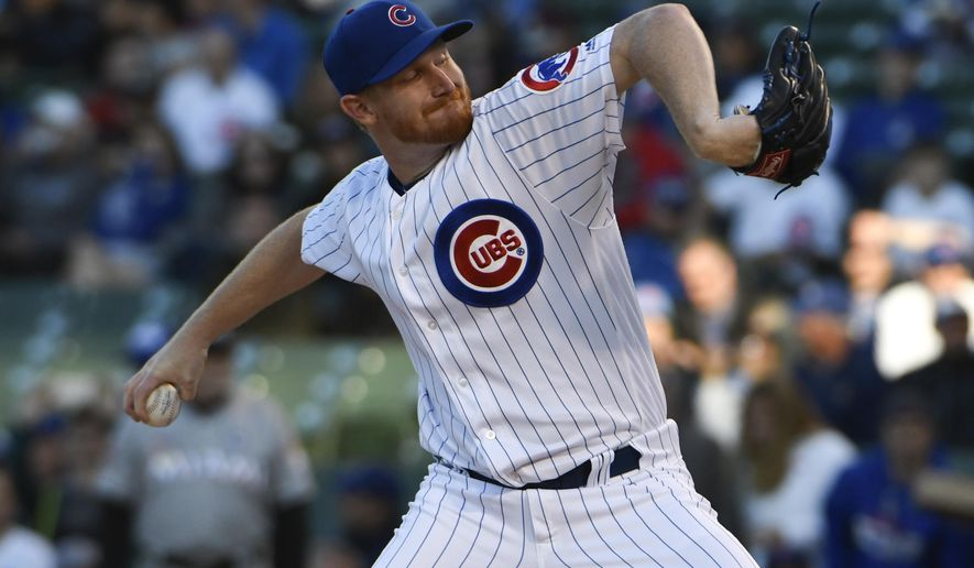 Chicago Cubs starting pitcher Eddie Butler (33) throws against the Miami Marlins during the first inning of a baseball game, Monday, June 5, 2017, in Chicago. (AP Photo/David Banks)