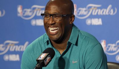 FILE - In this June 1, 2017, file photo, Golden State Warriors interim head coach Mike Brown smiles during a news conference before Game 1 of basketball's NBA Finals between the Warriors and the Cleveland Cavaliers, in Oakland, Calif.  The Warriors well-liked top assistant, whose first stint as a head coach was to nurture a young LeBron James, is heading to Cleveland, the city that shaped him more personally and professionally than any other.(AP Photo/Jeff Chiu, File)