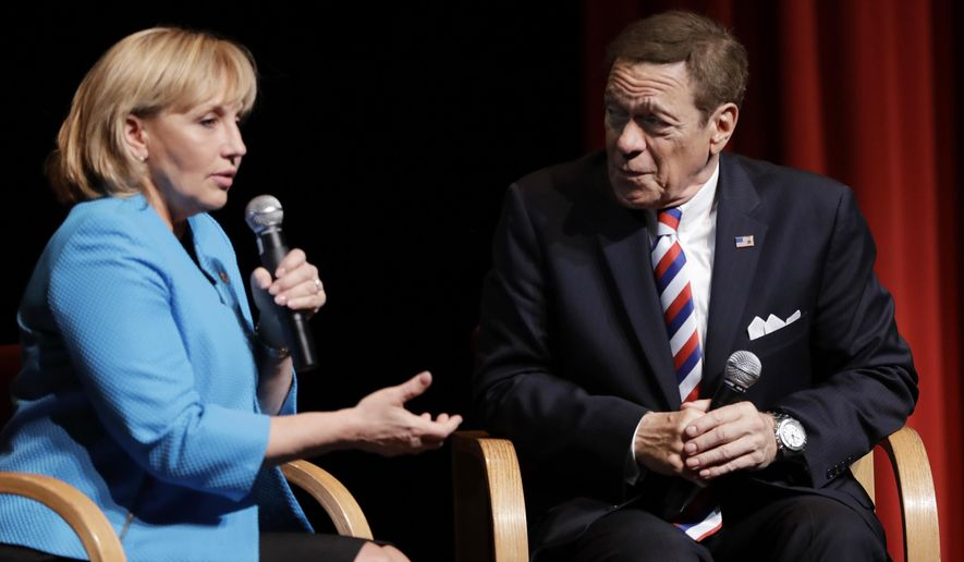 """FILE - In this May 3, 2017 file photo, New Jersey Lt. Gov. Kim Guadagno, left, and former """"Saturday Night Live"""" comedian Joe Piscopo join in a news conference in Paramus, N.J. Piscopo announced he will not be launching an independent campaign to succeed Republican Gov. Chris Christie and will endorse Guadagno during her bid in the primary elections for gubernatorial race. (AP Photo/Julio Cortez, File)"""