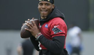FILE - In this May 30, 2017, file photo, Carolina Panthers' Cam Newton runs a drill during an NFL football practice in Charlotte, N.C. Panthers coach Ron Rivera says quarterback Cam Newton is ahead of schedule in his rehab from shoulder surgery and is expected to begin throwing next week at minicamp. (AP Photo/Chuck Burton, File)