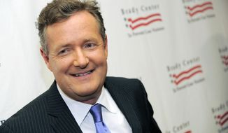 "FILE - This May 7, 2013, file photo, shows Piers Morgan at the Brady Campaign to Prevent Gun Violence Los Angeles Gala in Beverly Hills, Calif. "" Morgan apologized to singer Ariana Grande on June 4, 2017, after initially criticizing her following the May 22, 2017, attack following her concert in Manchester, England. (Photo by Chris Pizzello/Invision/AP, File)"