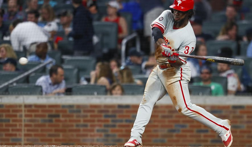 Philadelphia Phillies Odubel Herrera (37) hits a 2 run homerun in the fourth inning of a baseball game against the Atlanta Braves, Monday, June 5, 2017, in Atlanta. (AP Photo/Todd Kirkland)
