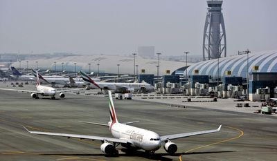 FILE - In April 20, 2010 file photo, an Emirates airline passenger jet taxis on the tarmac at Dubai International airport in Dubai, United Arab Emirates. Emirates said it is suspending flights to Qatar amid a growing diplomatic rift. The airline said on its website Monday, June 5, 2017, that flights would be suspended until further notice starting Tuesday. (AP Photo/Kamran Jebreili, File)