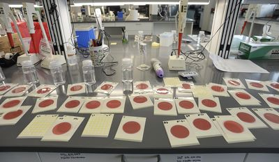 In this Thursday, June 1, 2017 photo, samples of coliform testing in milk are studied at the new Department of Agriculture and Food in Taylorsville, Utah. The new building also houses the office of the Medical Examiner and the Department of Public Safety. (Francisco Kjolseth/The Salt Lake Tribune via AP)