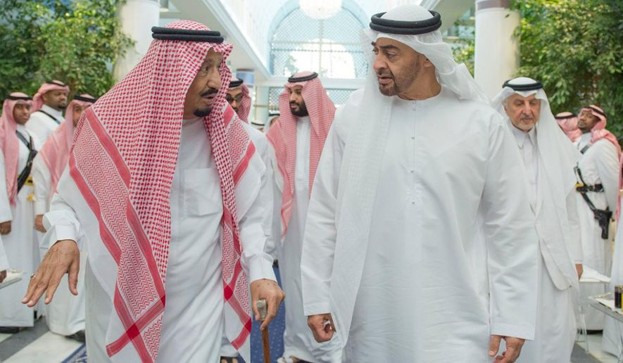 In this Friday, June 2, 2017 photo released by Saudi Press Agency, SPA, Saudi King Salman bin Abdulaziz Al Saud, left, talks to Sheikh Mohammed bin Zayed Al Nahyan, Abu Dhabi's Crown Prince and Deputy Commander in Chief of the Emirates Armed Forces in Jiddah, Saudi Arabia. Four Arab nations cut diplomatic ties to Qatar early Monday morning, June 5,  further deepening a rift among Gulf Arab nations over that country's support for Islamist groups and its relations with Iran. (Saudi Press Agency via AP)