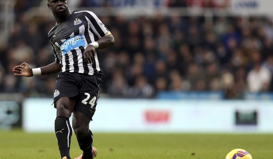 FILE - In this Saturday, Dec. 6, 2014 file photo, Newcastle United's Cheick Tiote plays the ball forward during their English Premier League soccer match against Chelsea at St James' Park, Newcastle, England. Cheick Tiote, a former Newcastle and Ivory Coast midfielder, has died after collapsing in training with a Chinese team it was announced on Monday, June 5, 2017. He was 30. (AP Photo/Scott Heppell, file)
