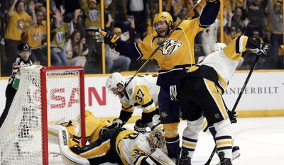 Nashville Predators right wing Craig Smith, center, celebrates a goal by teammate Calle Jarnkrok, not shown, as Pittsburgh Penguins goalie Matt Murray, bottom, falls on the ice during the first period in Game 4 of the NHL hockey Stanley Cup Finals Monday, June 5, 2017, in Nashville, Tenn. (AP Photo/Mark Humphrey)