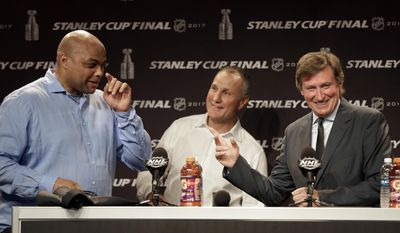Former NBA player and current television analyst Charles Barkley, left, jokes with hockey greats Wayne Gretzky, right, and Paul Coffey, center, during a news conference before Game 4 of the NHL hockey Stanley Cup Finals between the Nashville Predators and the Pittsburgh Penguins Monday, June 5, 2017, in Nashville, Tenn. (AP Photo/Chuck Burton)