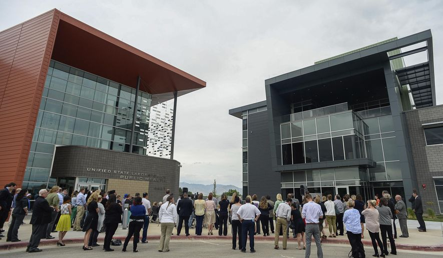 In this Thursday, June 1, 2017 photo, the Department of Public Safety celebrates the opening of the new Unified State Laboratory, that includes the Utah State Medical Examiner's Office and the Department of Agriculture and Food, in Taylorsville, Utah. (Francisco Kjolseth/The Salt Lake Tribune via AP)