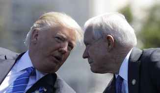 President Donald Trump talks with Attorney General Jeff Sessions, gestures before speaking at the 36th Annual National Peace Officers' memorial service, Monday, May 15. 2017, on Capitol Hill in Washington.  (AP Photo/Evan Vucci)